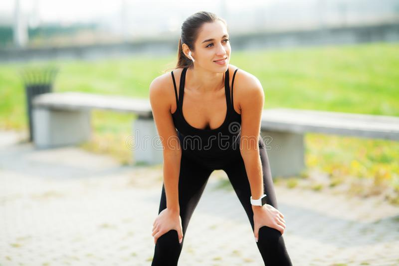 Sports woman after sports exercises in the urban environment. stock photography