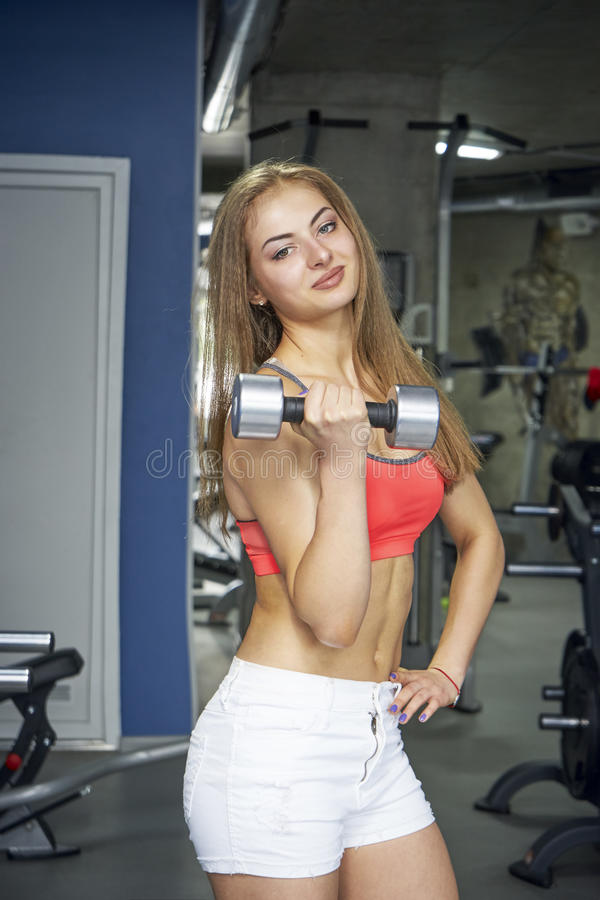 Sports woman trains biceps stock photos