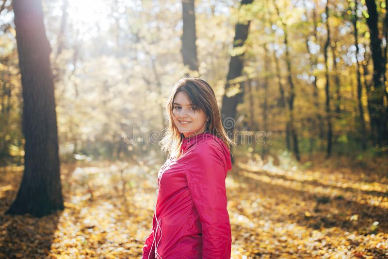 Sports woman trains in the morning autumn forest. Close up portrait stock image