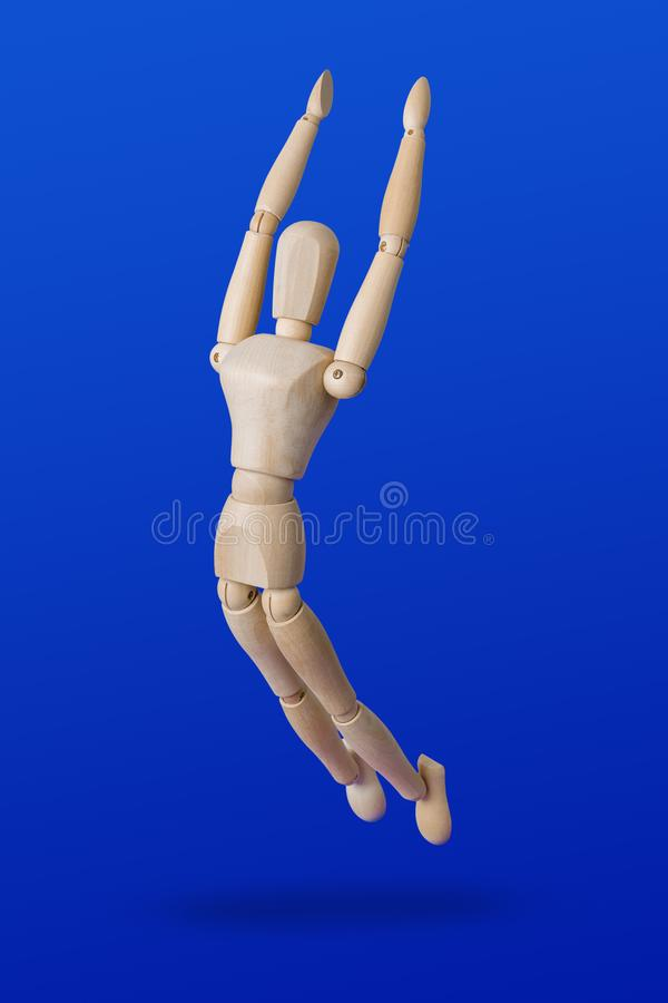 Sports wooden toy figure on blue royalty free stock image