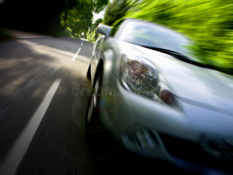 Sportscar driving fast at speed. Toyota MR2 / MRS roadster sports car speeding past in country lane stock photos
