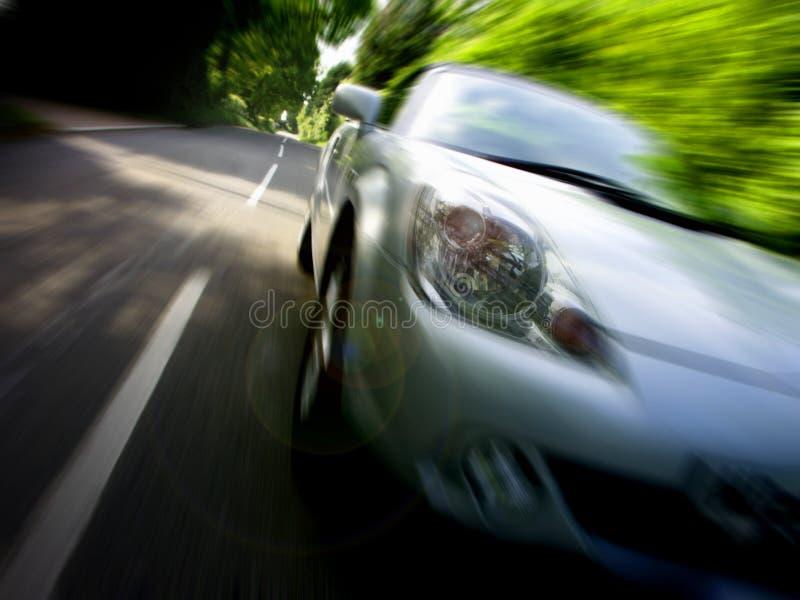 Sportscar que conduce rápidamente fotos de archivo