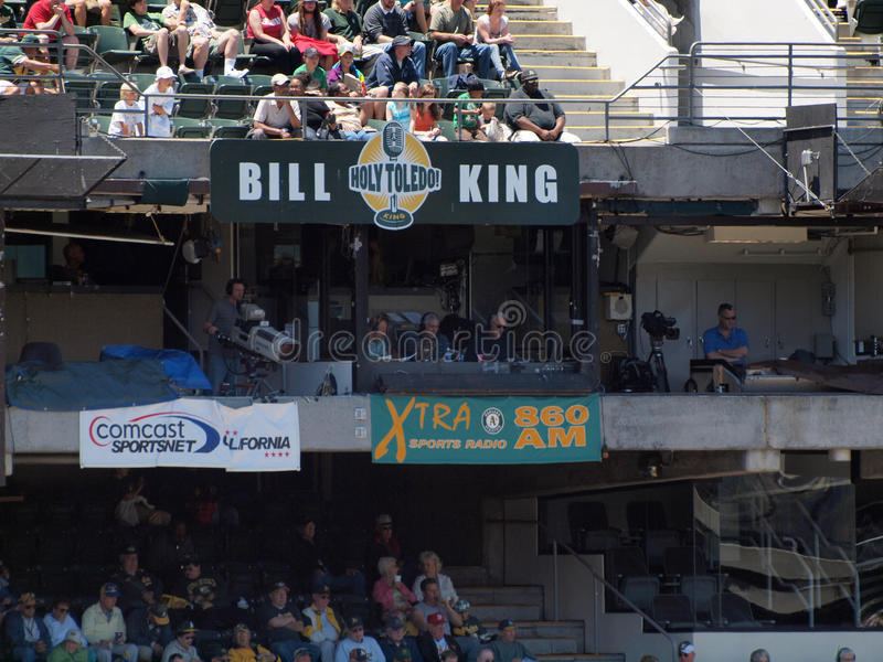 Sportscasters call game from Xtra 860am Radio booth at Baseball. OAKLAND, CALIFORNIA - JUNE 23: Sportscasters call game from Xtra 860am Radio booth next to royalty free stock photo
