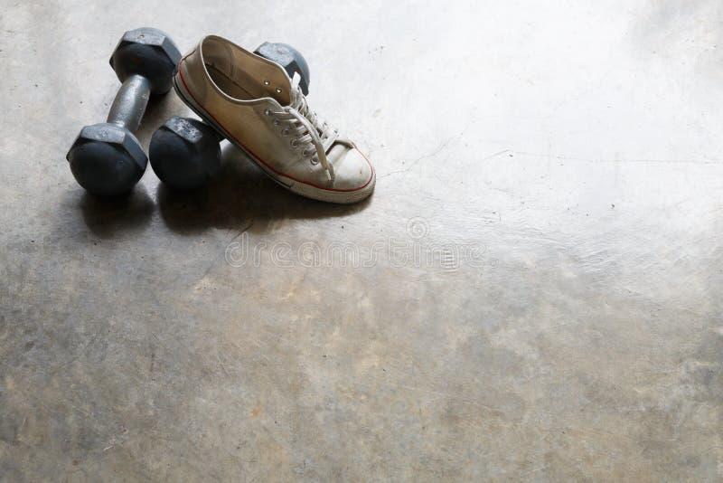 Sportsko- och metallhantel, konditionsportutrustning royaltyfri foto