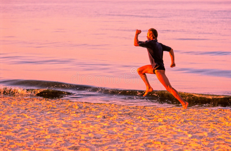 Sportsman. Does jog in early morning along seacoast royalty free stock photos