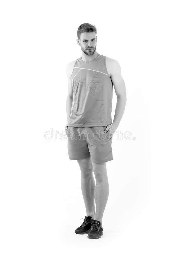 Sportsman in active wear and shoes for running isolated on white background. Bearded man in blue sport clothes and. Sneakers. Sport fashion style and trend royalty free stock photography