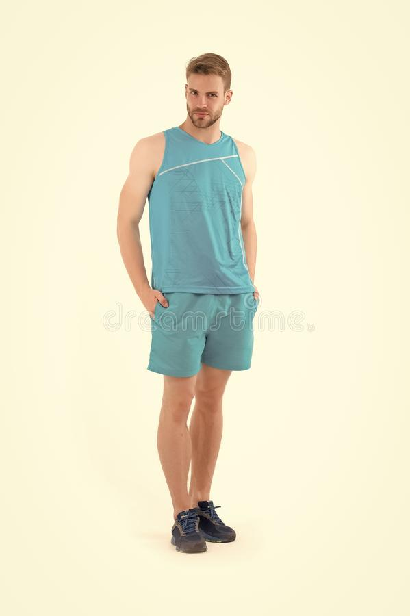 Sportsman in active wear and shoes for running isolated on white background. Bearded man in blue sport clothes and. Sneakers. Sport fashion style and trend stock photos