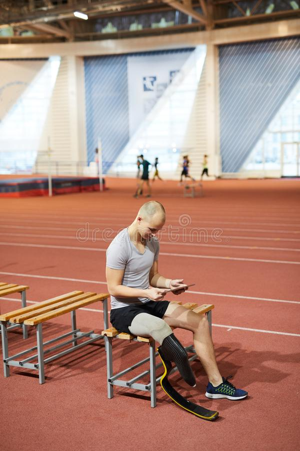 Sportsman with tablet royalty free stock images