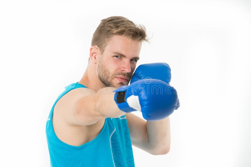 Sportsman boxer concentrated training boxing gloves. Man concentrated face in blue gloves practice fighting skills royalty free stock image