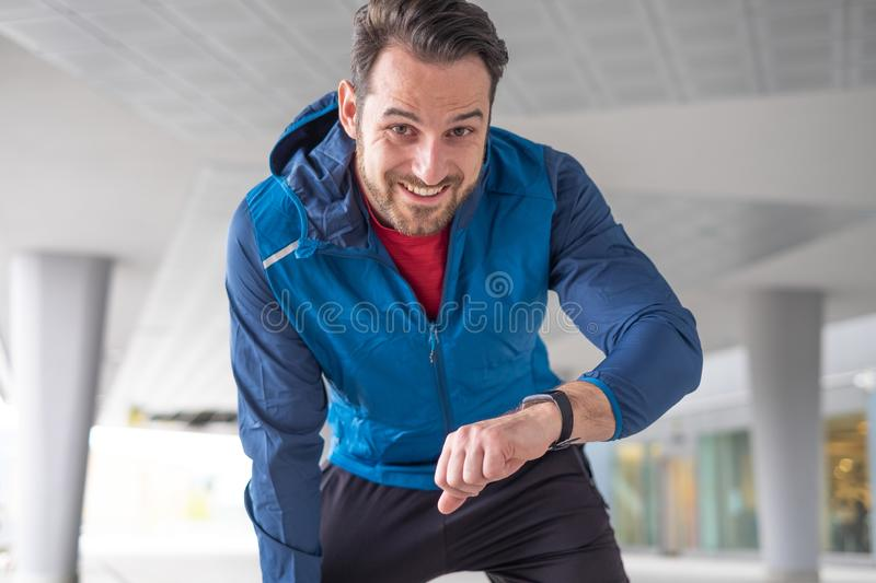 Sportsman checking sportwatch data and personal record stock photography