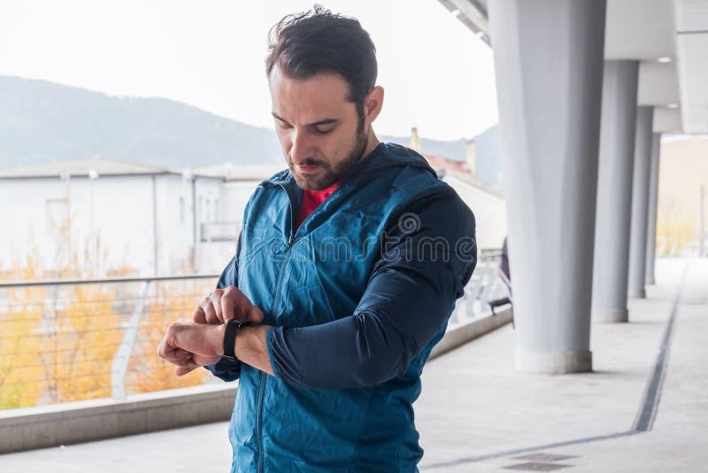 Active man portrait using smartwatch fitness app royalty free stock photo