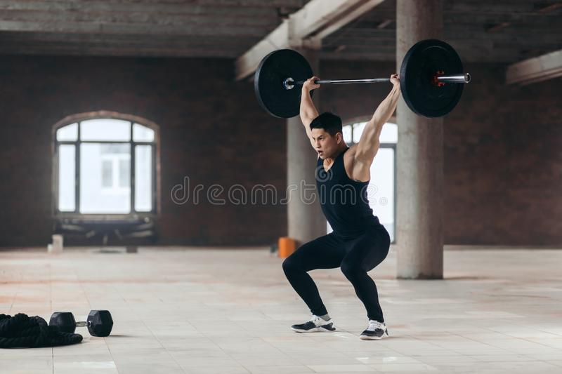 Sportsman developing musculature through progressive resistance exercise royalty free stock photos