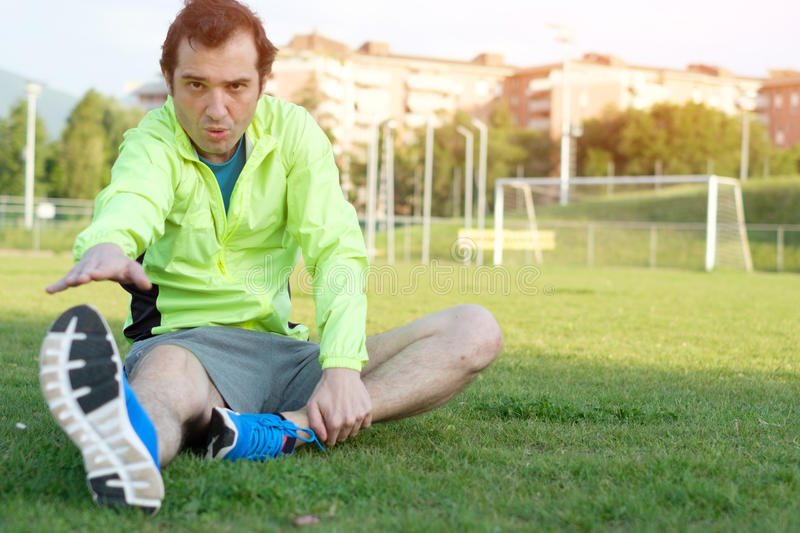 Sportsman doing exercises in a soccer field royalty free stock photos
