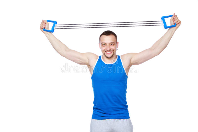 Sportsman Doing Fitness Exercises With Expander Stock Photo