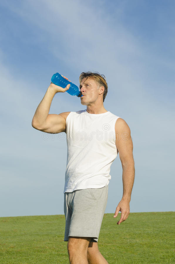Download Sportsman Drinking From Water Bottle. Stock Photo - Image: 25177994
