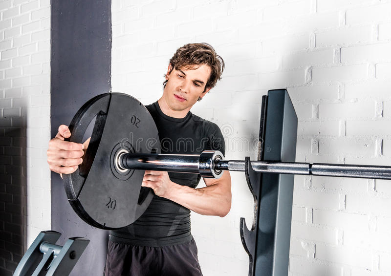 Sportsman exercising in gym royalty free stock photos
