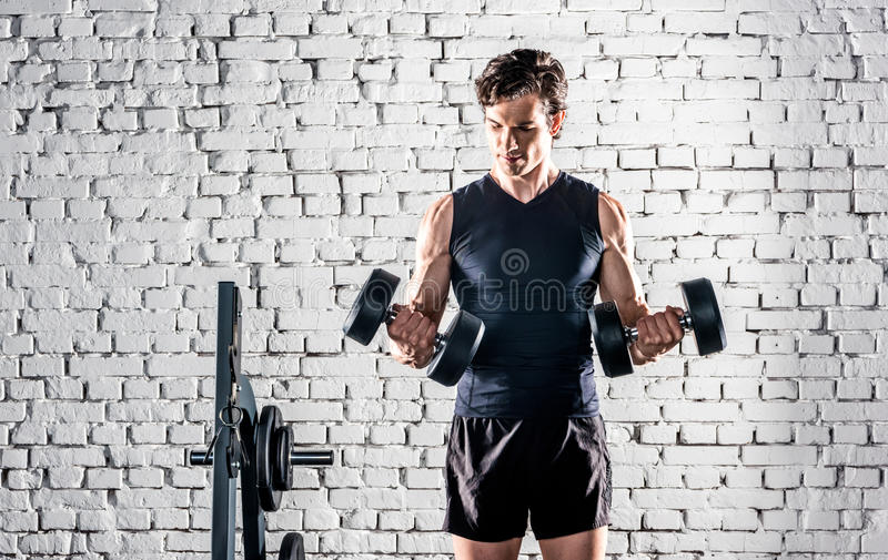 Sportsman exercising in gym stock image