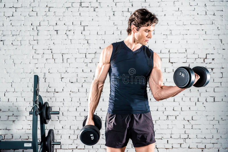 Sportsman exercising in gym stock photography