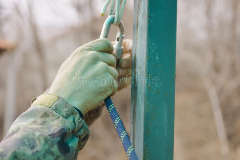 The sportsman hangs up carbine in hook stock photo