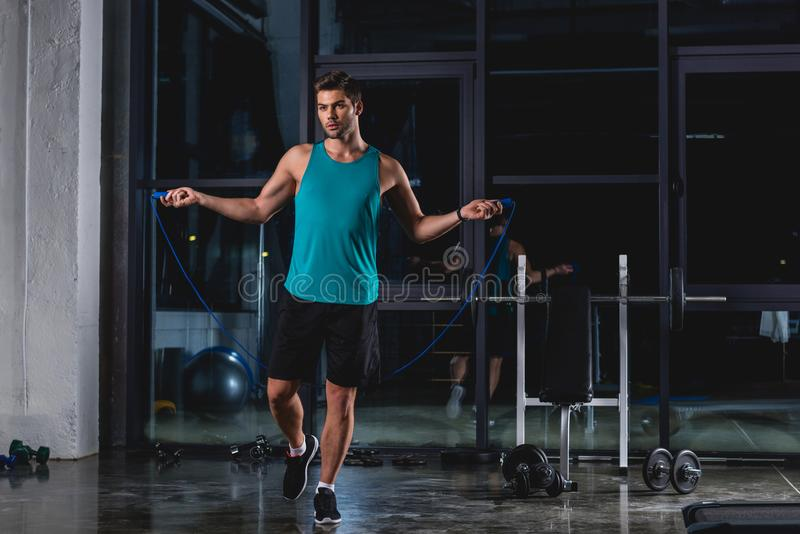 Sportsman jumping with skipping rope. In gym stock photography