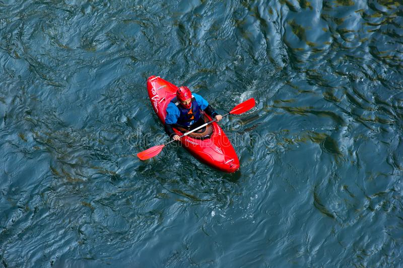 sportsman kayaker comes down on a kayak along the mountain river Belaya in Adygea in the autumn time, the top view stock photography