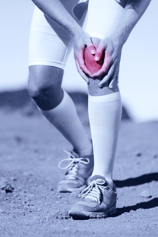 Sportsman with a knee injury stock photos