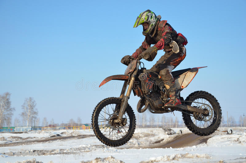 Sportsman on the motorcycle flies through the air royalty free stock photos