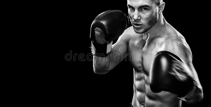 Sportsman muay thai boxer fighting in boxing cage. Isolated on black background with copy Space. Black and white photo stock photography