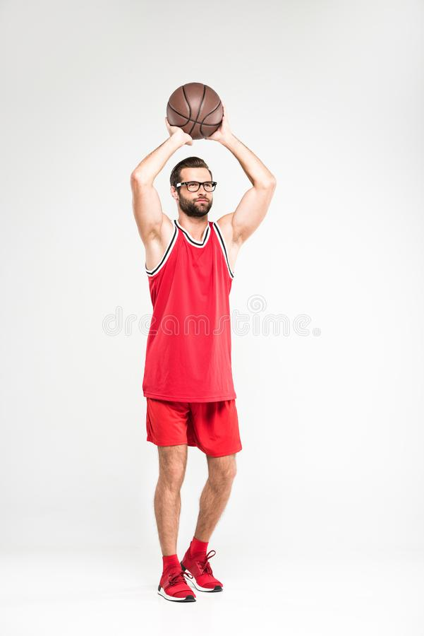 sportsman in red sportswear and retro glasses playing basketball, royalty free stock photography
