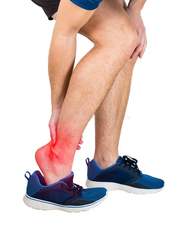 Sportsman suffering ankle pain royalty free stock images