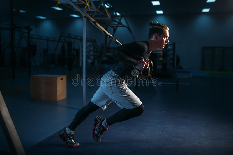 Sportsman on training,endurance workout with ropes stock photos