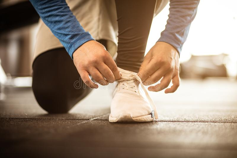 Sportsman tying sneakers and preparation for exercise. stock photography