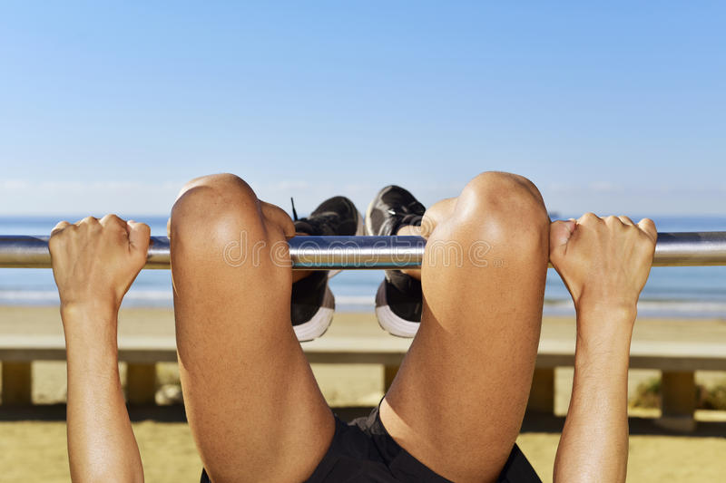 Sportsman upside down in a metal bar stock photography