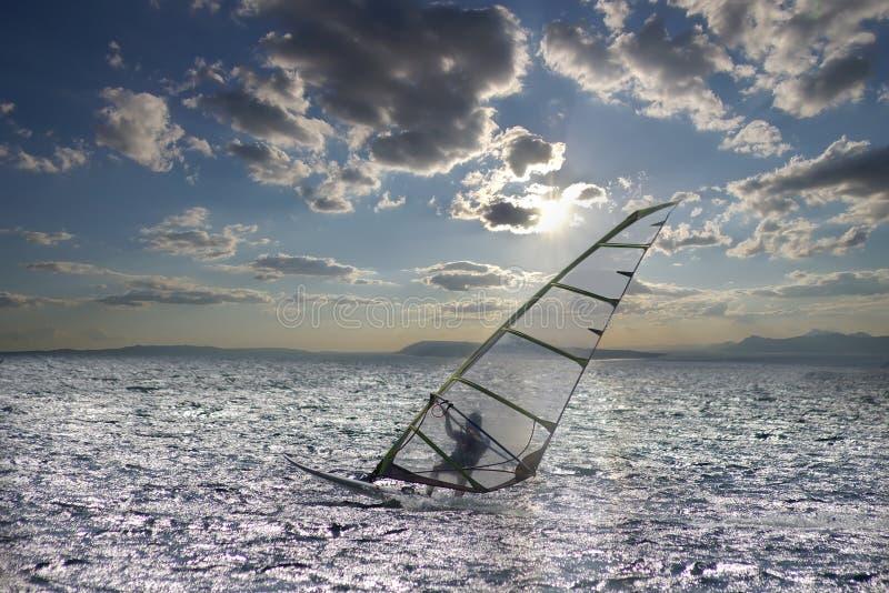 Sportsman on windsurfing stock photos