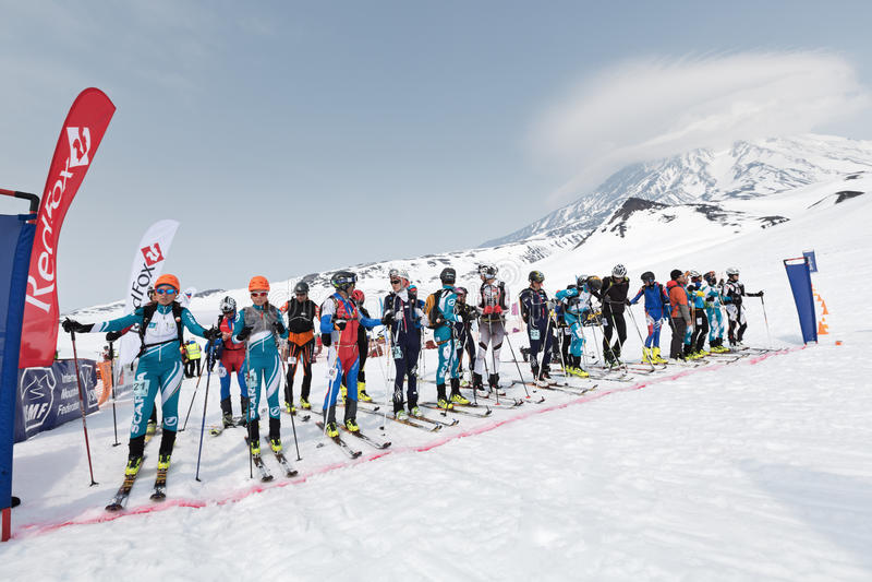 Sportsmans ski mountaineers at the starting line. Team Race ski mountaineering. Kamchatka, Russia. AVACHA AND KORYAK VOLCANOES, KAMCHATKA, RUSSIA - APRIL 27 royalty free stock images