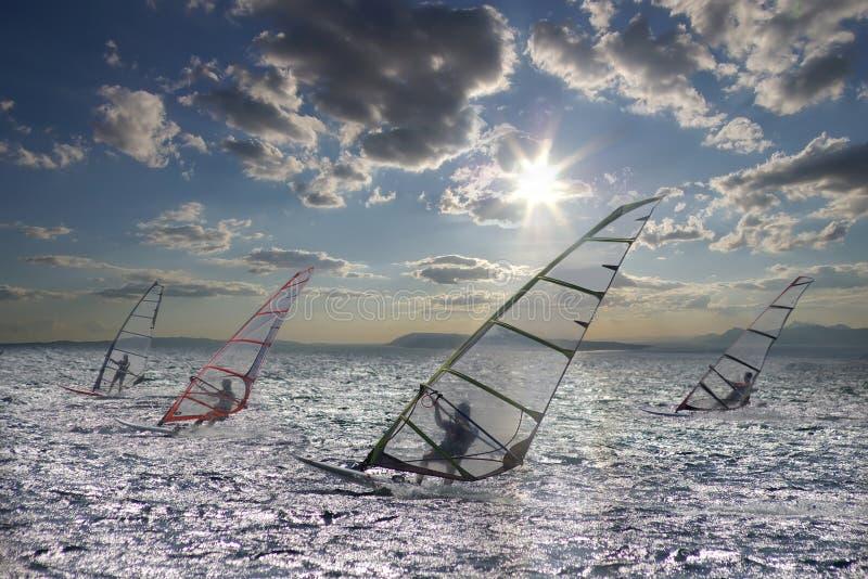 Sportsmans on windsurfing. On a photo: Sportsmans on windsurfing stock photography