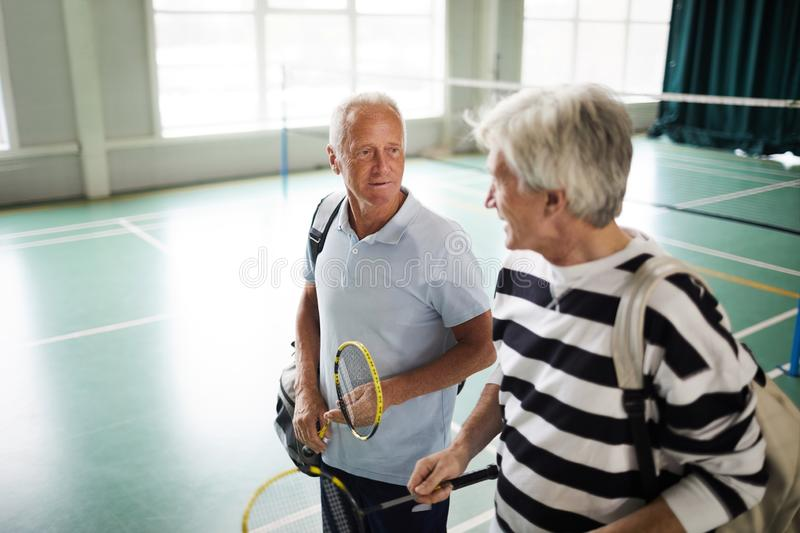 Sportsmen leaving leisure center royalty free stock photography