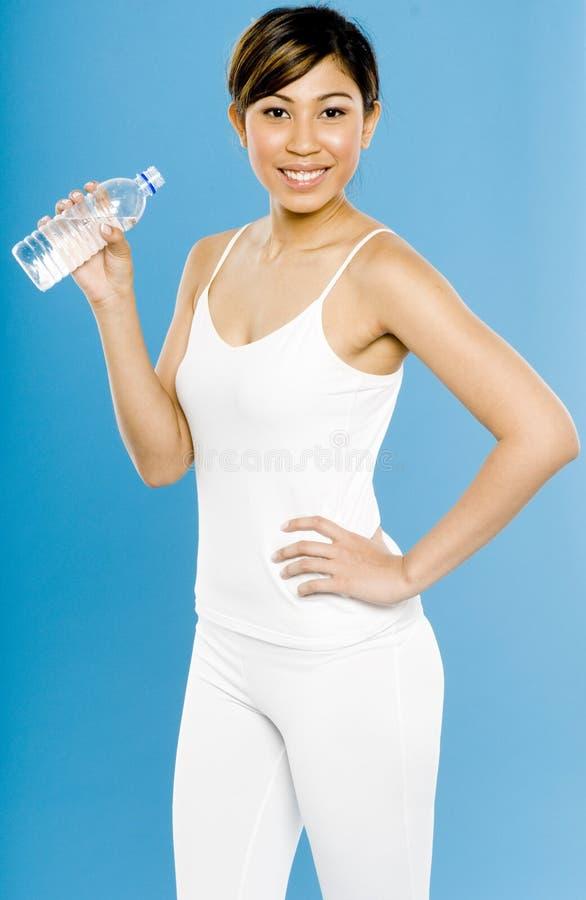 Sportswoman в белизне стоковое изображение