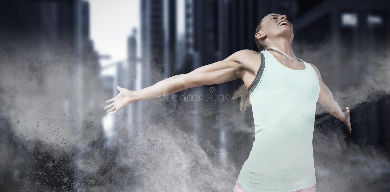 Composite image of sportswoman celebrating her victory royalty free stock photos