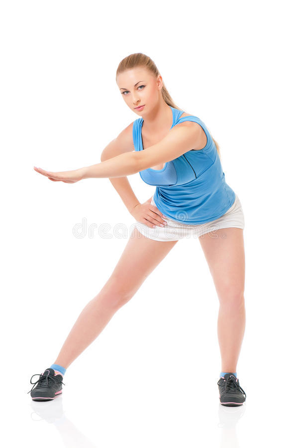 Sportswoman doing stretching exorcises royalty free stock photos