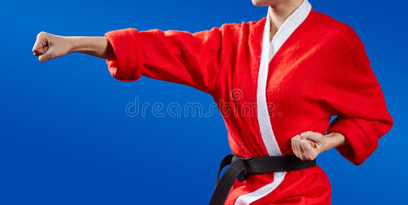 Sportswoman dressed as Santa Claus hits a punch hand. Sportswoman dressed as Santa Claus hits a punch royalty free stock images