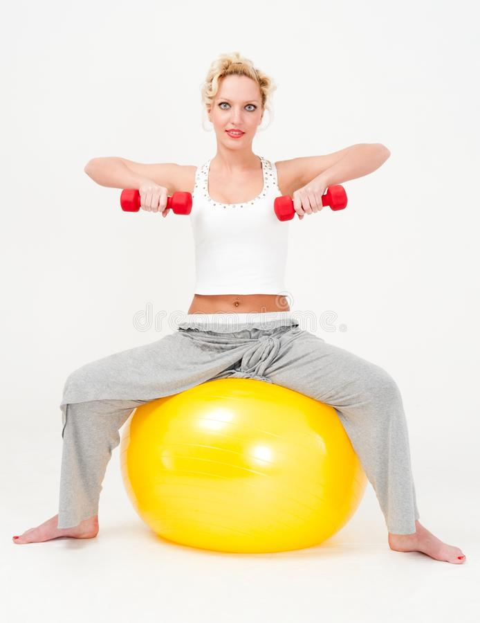 Sportswoman Exercising With Dumbbells Stock Images