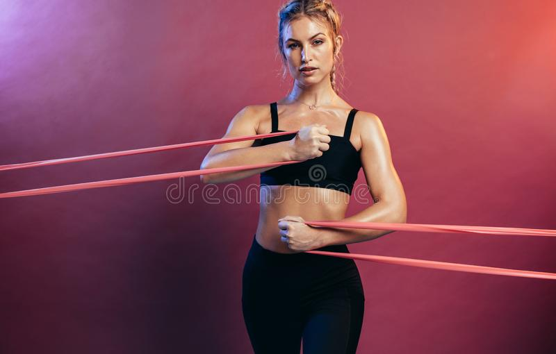 Sportswoman exercising with resistance bands stock photography