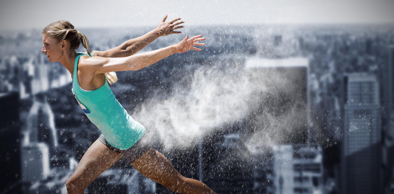 Composite image of sportswoman finishing her run stock photo