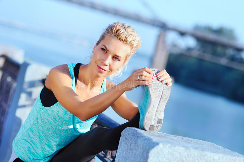 sportswoman during her stretch stock images