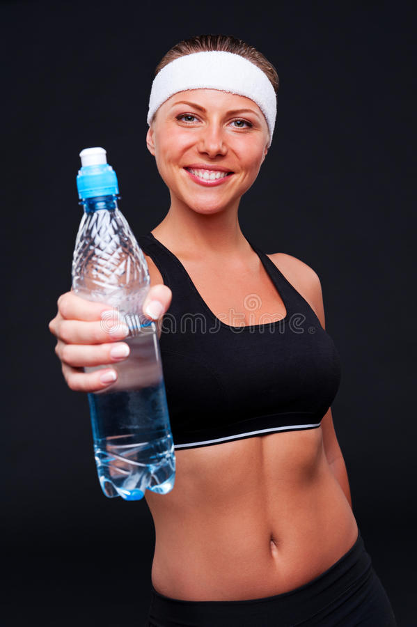 Download Sportswoman Holding Bottle Of Water Stock Image - Image: 26401791