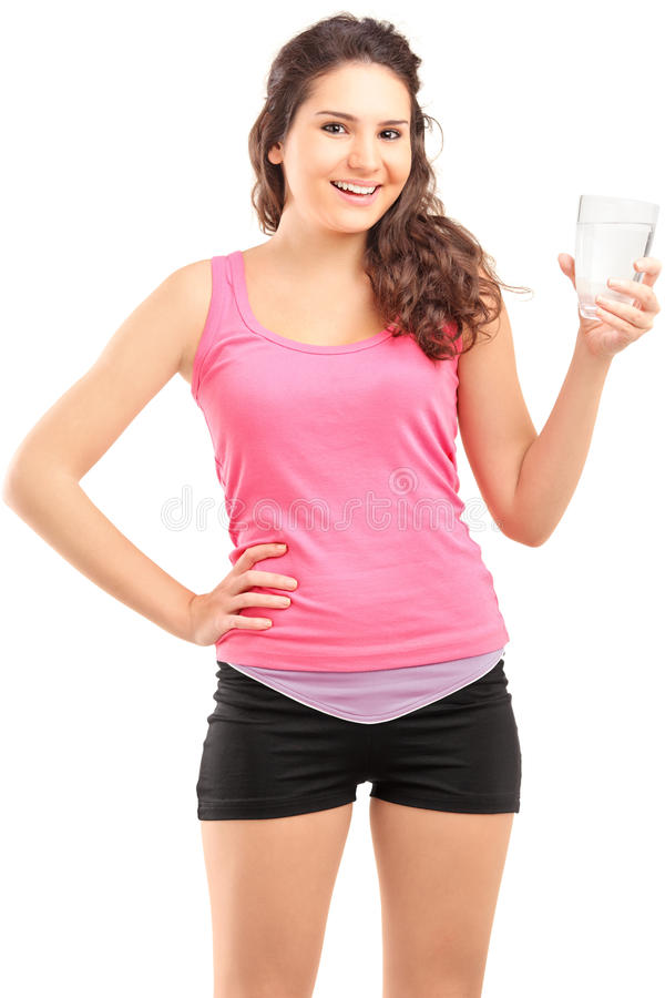Sportswoman Holding A Glass Of Water Royalty Free Stock Photo