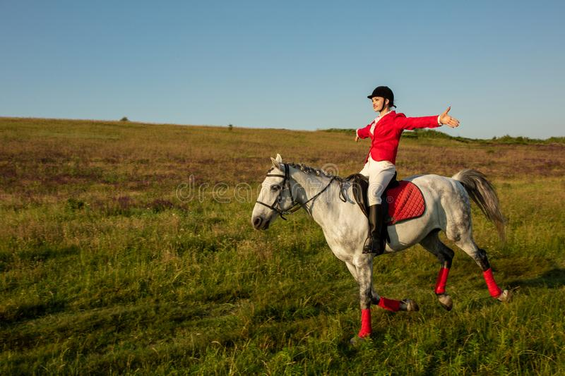 The horsewoman on a red horse. Horse riding. Horse racing. Rider on a horse. The sportswoman on a horse. The horsewoman on a red horse. Equestrianism. Horse stock image