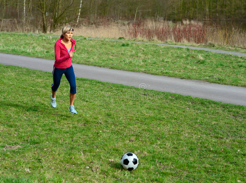 Download Sportswoman Playing With A Ball Royalty Free Stock Photography - Image: 9123777