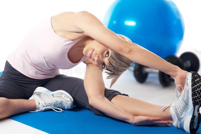 Sportswoman stretching royalty free stock photo